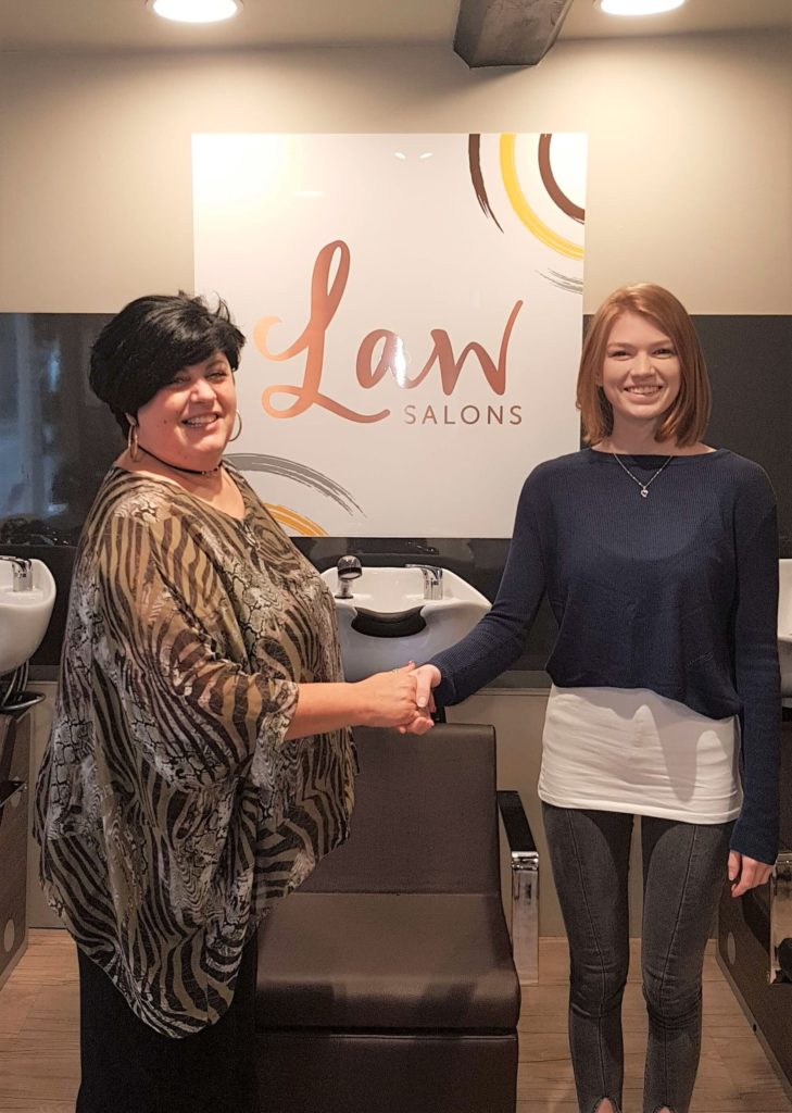 Saks Educator Cinzia Taylor congratulates Law Salons Apprentice Grace on achieving Distinction in her End Point Assessment for NVQ2